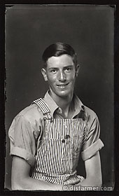Young Man in Striped Overalls