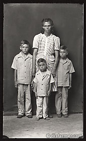 Woman in Striped Dress with Three Sons