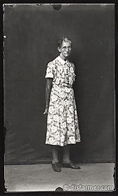 Older Woman in Flower Dress and Glasses