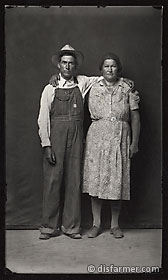 Main in Overalls, Woman in Flower Dress