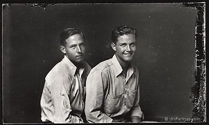 Two Young Men Sitting Together