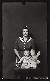 Mother and Child with Stuffed Bunny and Pail