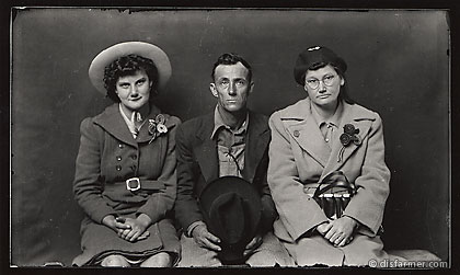 Man Holding Hat with Two Women