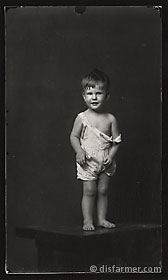 Young Boy in Falling Overalls