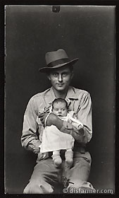 Man in Fedora with infant Daughter