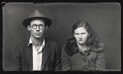 Man in Fedora and Glasses with Wife