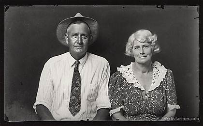 Older Couple Sitting, Man with Straw Hat